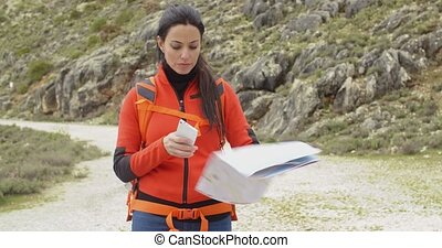 Active attractive woman checking a map - Active attractive...