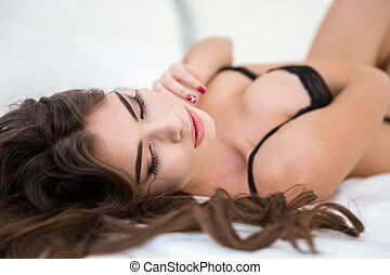 Woman in lingerie lying on the bed - Portrait of a sexy...
