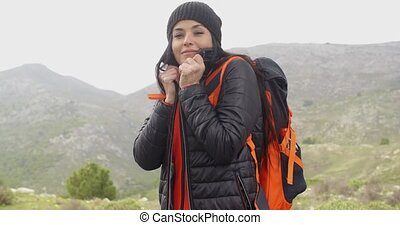 Young active woman hiking in winter - Young active woman...