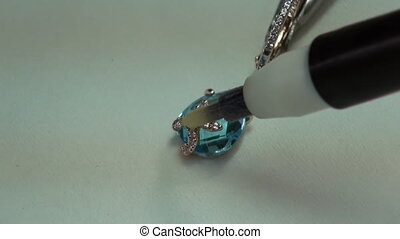 Painting gems acid in jewelry. Production and making...