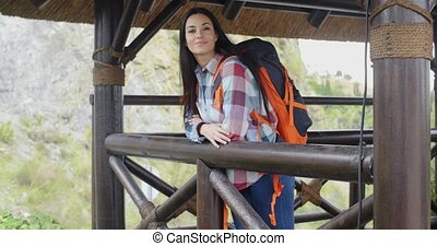 Smiling backpacker on a mountain lookout - Smiling...