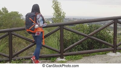 Young woman with a backpack admiring the scenery - Young...