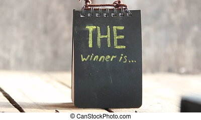 The Winner Is card - The Winner Is text Chalk inscription,...