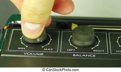 Spin the Volume Control on the Tape Recorder. - Man fingers...