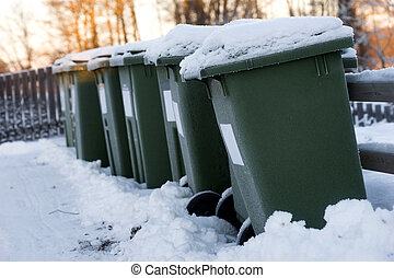Garbage cans in a row - Green garbage cans in a row with...