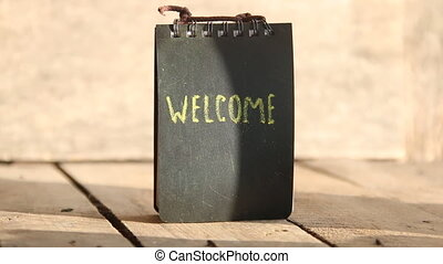 welcome hand lettering - Welcome word on a chalkboard Chalk...