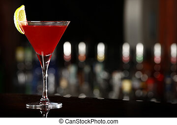 cosmopolitan drink over black bar