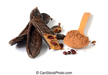 Ripe carob pods and carob powder, can be used as a...