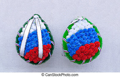 Mourning wreaths on wall background - Two mourning wreaths...