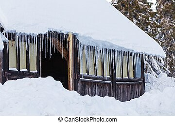 Icicles on old house - Photo of icicles hanging on old house