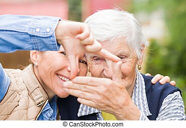 Elderly woman with grandchild - Photo of elderly woman with...