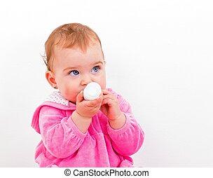 Adorable baby girl - Photo of an adorable baby girl nibbles...
