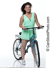 Girl on Bike - Young woman on a bike with a white background...