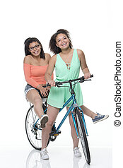 Friends on a bike - Two friends on a bike with a white...