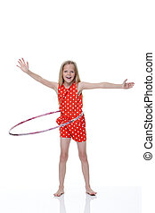 Hoola Hoop - Young girl with plastic hoop around her waist...