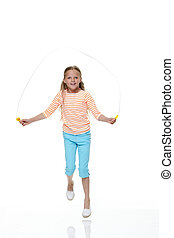 Skip Skip - Portrait of a young girl skipping with a white...
