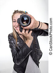 Snapshot - Teenage girl taking a photo with a camera