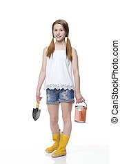 Young Gardening - Young girl with a trowel and watering can...