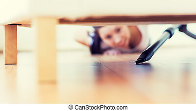 close up of woman with vacuum cleaner at home - people,...
