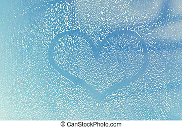 close up of heart shape on soapy window glass - people,...