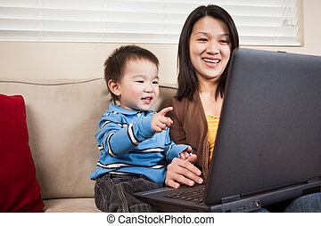 Mother and son with laptop - A portrait of a mother and a...