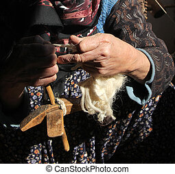 Women spinning wool