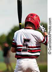 Youth baseball boy up to bat - Little league baseball player...