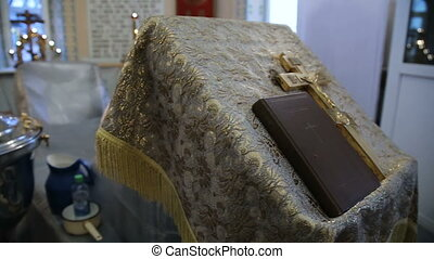 Orthodox cross with bible in church