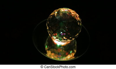 crystal ball - A plain crystal ball, sitting on black cloth