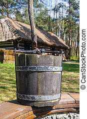 old wood bucket, water well