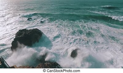 Big Ocean Waves Breaking on Rock, storm weather