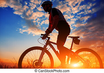 biker in autumn on a sunny afternoon - Silhouette of a biker...