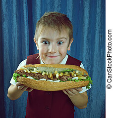 Boy eating big sandwiches - young Boy eating big sandwiches