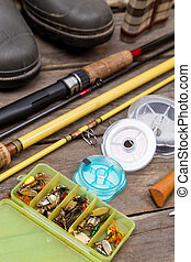 fishing tackles for journey on wooden boards - different...