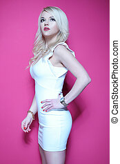 blonde woman in white dress on pink