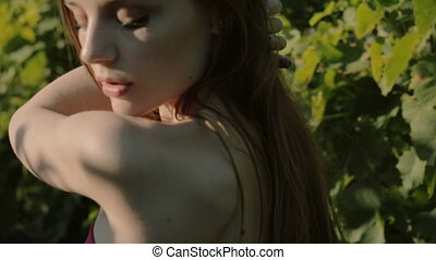 Seductive young woman posing in the vineyards - Seductive...