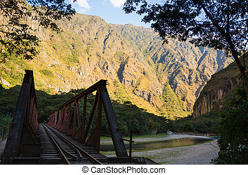 Iron bridge on the railway track to Machu Picchu, Peru -...