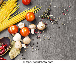 Italian meal ingredients with pasta,spices,tomatoes and mushrooms