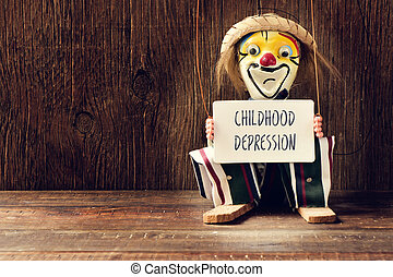 old marionette with a signboard with the text childhood...