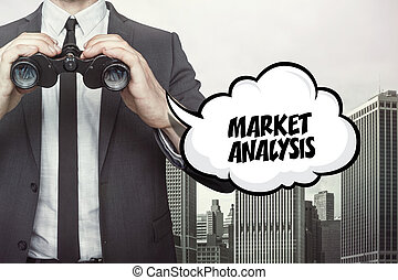 Market analytics text on speech bubble with businessman...