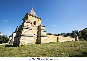 Fortified monastery in Bucovina - Surrounding high walls of...