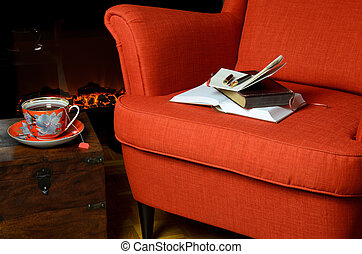 Books and cup of tea by the fireplace - Books, notepad and...