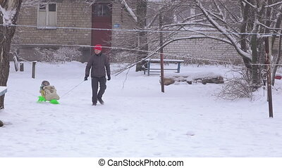 Father and child in snow