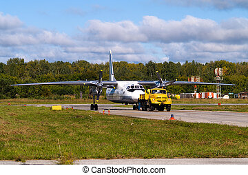 aircraft in a tow with a truk