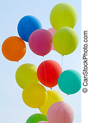 colored balloons on blue sky