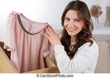 Woman unpacking her online order in the living room