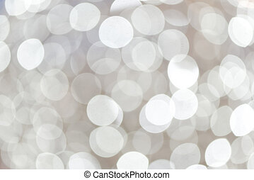 Defocused white lights during winter evening in city