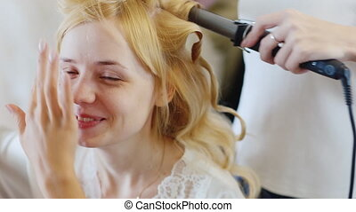 Blonde bride doing makeup