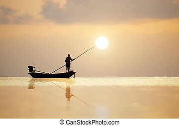 Silhouettes of fisherman at the lake, Thailand - Silhouettes...
