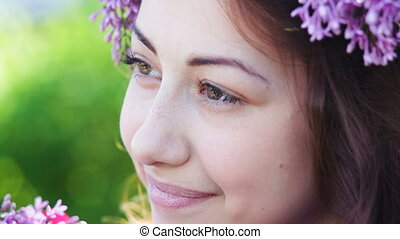 happy woman with a wreath of lilac